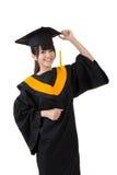 La giovane donna asiatica di graduazione è felice Fotografie Stock Libere da Diritti