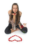 La giovane donna con è aumentato Fotografia Stock Libera da Diritti
