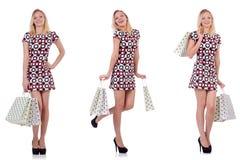 La giovane donna con i sacchetti della spesa su bianco Immagine Stock Libera da Diritti