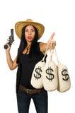 La giovane donna con i sacchi dei soldi e della pistola Fotografie Stock Libere da Diritti