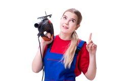 La giovane donna con la sega elettrica isolata su bianco Immagini Stock Libere da Diritti