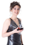 La giovane donna con un vetro di vino Fotografie Stock