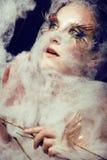La giovane donna graziosa con creativo compone Fotografia Stock Libera da Diritti