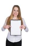 La giovane donna indica una lavagna per appunti con il suo dito Fotografia Stock Libera da Diritti