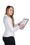 La giovane donna indica una lavagna per appunti con il suo dito Immagine Stock Libera da Diritti