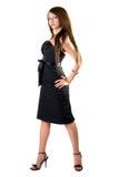 La giovane donna sexy in un vestito nero Immagine Stock