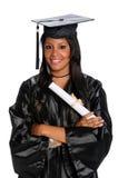 La giovane donna si è vestita in abito di graduazione Fotografie Stock