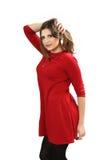 La giovane donna in un vestito rosso Immagini Stock Libere da Diritti