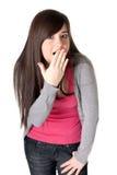 La giovane femmina adulta si è sorpresa isolato su bianco Immagini Stock