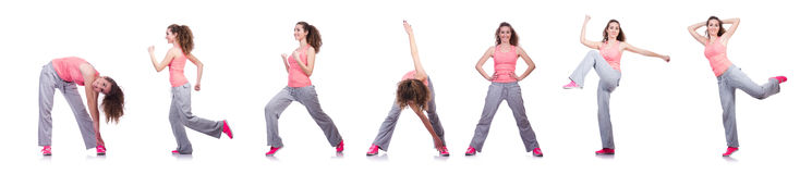 La giovane femmina che fa gli esercizi su bianco Fotografie Stock