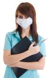 La giovane infermiera attraente con un dispositivo di piegatura isolato Fotografie Stock