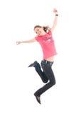 La giovane ragazza di salto isolata su un bianco Immagini Stock