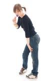 La giovane ragazza in modo divertente con un fittizio isolata Immagini Stock Libere da Diritti