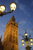 La Giralda, Seville, Spain. La Giralda is one of the most famous landmarks in Seville. Once minaret of the ancient Seville mosque, it's been used by the stock photo
