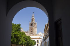La Giralda Tower through an arch Royalty Free Stock Photography