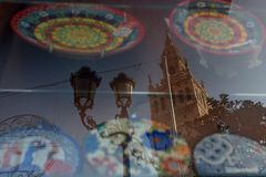 Ceramic plates with a reflection of the Giralda in Seville stock photo