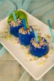 La glace bleue saute le dessert Photos stock