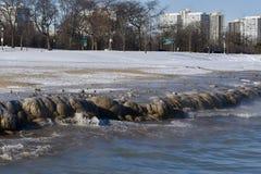 La glace a couvert la plage Photos stock