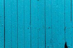 La gocciolina di acqua sulla porta del cielo blu Immagine Stock Libera da Diritti