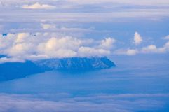La Gomera island behind the clouds in Tenerife, Spain.  stock images
