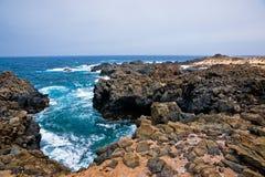 La Graciosa - rotsachtige kust. Stock Foto