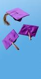 La graduazione ricopre il volo nell'aria Fotografia Stock