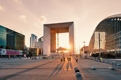 La Grande Arche at sunset. PARIS, FRANCE - MAY 18, 2014: The Arche is in the approximate shape of a cube (110mt) and was inaugurated in July 1989, for the Royalty Free Stock Images