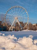 The Montreal Observation Wheel at Old Port in Montreal with a Sn stock photo