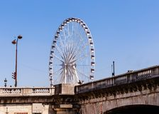 La Grande Roue Ferris Wheel, near the Place de la Concorde. Bridge of Concord , Paris, France Stock Photos