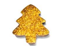 La grasa de los pescados de las cápsulas de Omega 3, ácidos se cierra para arriba en una placa bajo la forma de abeto en un fondo imágenes de archivo libres de regalías
