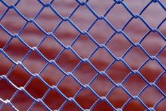 La griglia sopra l'acqua rossa Fotografie Stock Libere da Diritti
