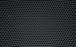 La grille métallique ronde tordue de Grey Macro troue la texture de ruche Image libre de droits