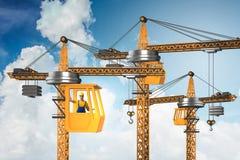 La grue de construction actionn?e par l'op?rateur photographie stock
