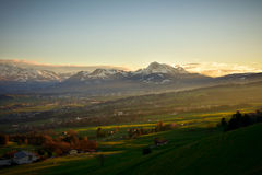 La Gruyére in Switzerland at sunset. Gruyère is a region that belongs to the district of Fribourg in Switzerland. It is most weel-known for is beautiful Royalty Free Stock Image