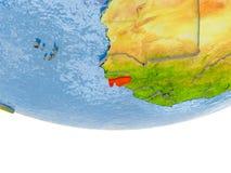 La Guinée-Bissau en rouge sur le modèle de la terre Photographie stock libre de droits