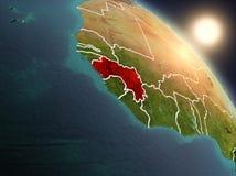 La Guinea da spazio durante l'alba Fotografia Stock