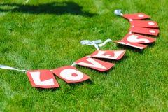 La guirlande avec amour de signes est des lettres Images libres de droits