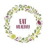 La guirlande a fait des plantes vertes, feuilles de salade, légumes, herbes et mange le slogan sain à l'intérieur Trame circulair illustration libre de droits