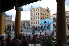 La Habana, Cuba - November 10th of 2014: Tourists take something to drink in Plaza Vieja. Stock Image