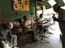 La Habana Miami. A walk to La Habana or Little Havana in Miami would give you a glimpse of the charming Cuban culture. Great music, good food, mojitos, and stock image