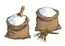 La harina de pan integral empaqueta con los oídos de madera de la cucharada y del trigo Imágenes de archivo libres de regalías