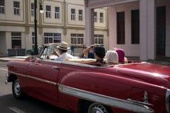 La Havana, Cuba. An old classic car full of tourists rolls down Malecon avenue, La Havana, Cuba Royalty Free Stock Image