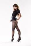 La hembra joven con desea las piernas en medias Imágenes de archivo libres de regalías
