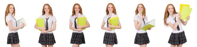 La hembra joven del estudiante con los libros de texto aislados en blanco Imagen de archivo libre de regalías