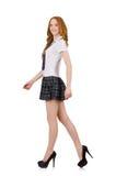 La hembra joven del estudiante que camina aislada en blanco foto de archivo libre de regalías