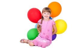 La holding di risata della bambina balloons il isolat del mazzo Fotografia Stock Libera da Diritti