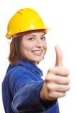 La holding femminile dell'operaio sfoglia in su Fotografia Stock