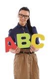 La holding graziosa dello schoolmistress segna il ABC con lettere Fotografie Stock Libere da Diritti