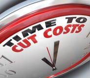 La hora de cortar costes reduce el pasar de un presupuesto más inferior Fotografía de archivo