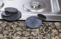 La hornilla de la estufa cubre mantenimiento Foto de archivo